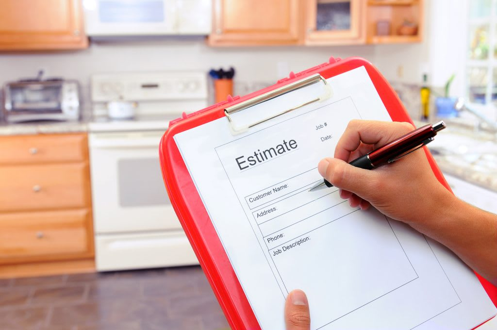 Closeup of a contractors clipboard as he writes up an estimate f